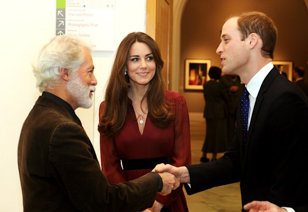 The Duke and Duchess of Cambridge meet artist Paul Emsley after viewing the newly-commissioned portrait of The Duchess of Cambridge at the National Portrait Gallery in central London, Friday Jan. 11,
