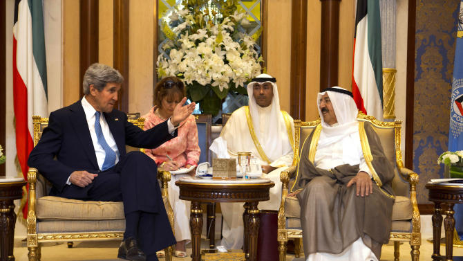 U.S. Secretary of State John Kerry, left, meets with Emir Sheik Sabah Al Ahmed Al Sabah, right, at Bayan Palace in Kuwait City Wednesday, June 26, 2013. (AP Photo/Jacquelyn Martin, Pool)
