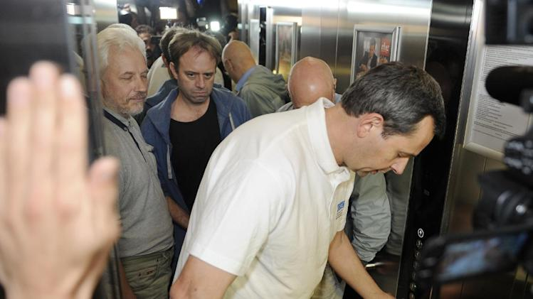 Unidentified freed OSCE observers arrive at a hotel in Donetsk early on June 27, 2014