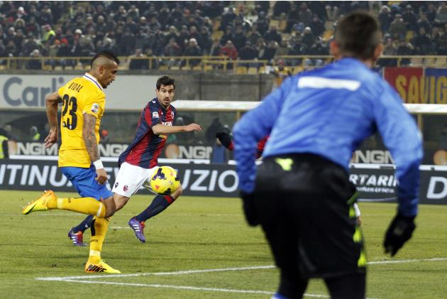 Juventus' Vidal kicks the ball to score against Bologna during their Italian Serie A soccer match at the Dall'Ara stadium in Bologna