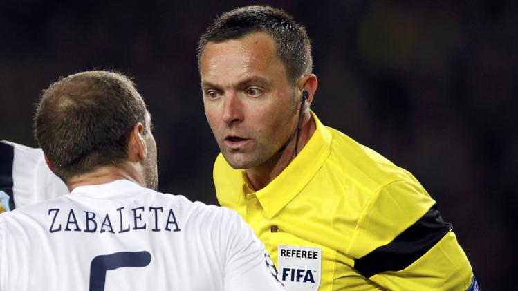 Manchester City's Zabaleta argues with referee Lannoy before receiving a red card during their Champions League last 16 second leg soccer match against Barcelona