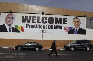 A banner showing U.S. President Barack Obama and Senegalese …