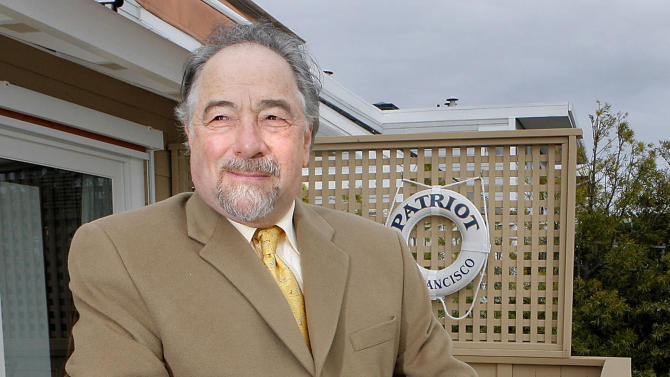 FILE - In this Dec. 3, 2007 file photo, radio talk show host Michael Savage poses with his dog Teddy in Tiburon, Calif. Savage won a legal battle Thursday Sept. 27, 2012 and announced he was leaving Talk Radio Network, which broadcast his show that attracted more than 8 million listeners a week. (AP Photo/John Storey)