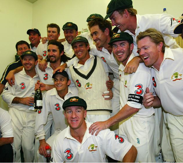 Matthew Hayden of Australia celebrates in the rooms with his team mates after scoring 380 to break Brian Lara of The West Indies world record of 375