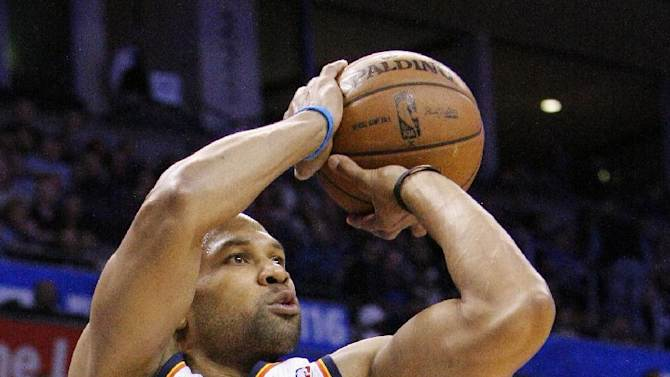Oklahoma City Thunder guard Derek Fisher shoots against the New Orleans Hornets during the second quarter of an NBA basketball game in Oklahoma City, Wednesday, Feb. 27, 2013. (AP Photo/Alonzo Adams)
