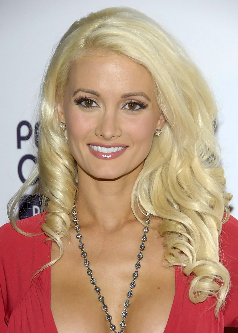 FILE - In this Oct. 12, 2008 file photo, model Holly Madison poses on the press line at the Hollywood Life 5th Annual Hollywood Style Awards in Los Angeles.  Burlesque performer and Las Vegas Strip star, Madison has announced she's going to be a first-time mom.(AP Photo/Dan Steinberg, file)