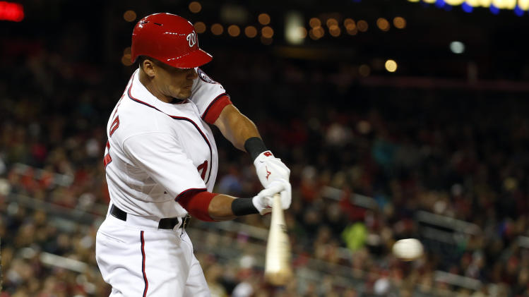 Washington Nationals' Ian Desmond hits a single during the seventh inning of a baseball game against the St. Louis Cardinals at Nationals Park, Friday, April 18, 2014, in Washington. The Nationals won 3-1. (AP Photo/Alex Brandon)