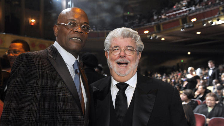 Samuel L. Jackson, left, and George Lucas pose in the audience at the 43rd NAACP Image Awards on Friday, Feb. 17, 2012, in Los Angeles. (AP Photo/Chris Pizzello)