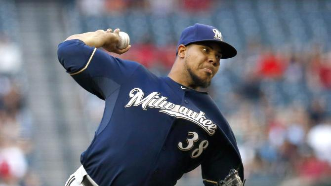Brewers score 6 late to beat D-backs 9-3