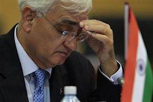 India's Foreign Minister Salman Khurshid reads a document during a pre-Commonwealth Heads of Government Meeting (CHOGM) in Colombo