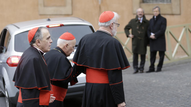 Cardinal Daniel Nicholas DiNardo, left, and Cardinal Sean Patrick O'Malley, right, arrive for a meeting, at the Vatican, Wednesday, March 6, 2013. Cardinals from around the world have gathered inside the Vatican for a round of meetings before the conclave to elect the next pope, amid scandals inside and out of the Vatican and the continued reverberations of Benedict XVI's decision to retire. (AP Photo/Alessandra Tarantino)