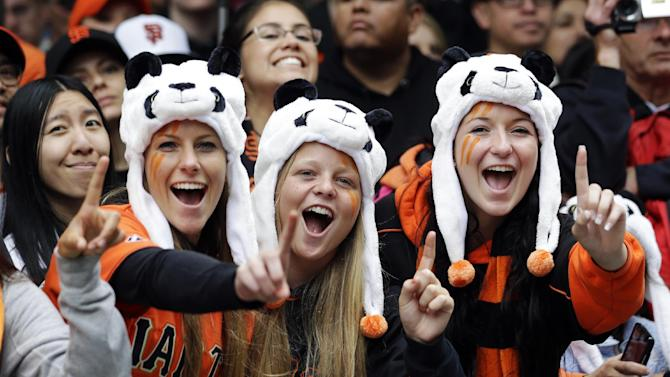 From left, San Francisco Giants fans Alison Griffith, Katie Peck and Beth Giotta cheer during the baseball team's World Series victory parade, Wednesday, Oct. 31, 2012, in San Francisco. (AP Photo/Marcio Jose Sanchez)
