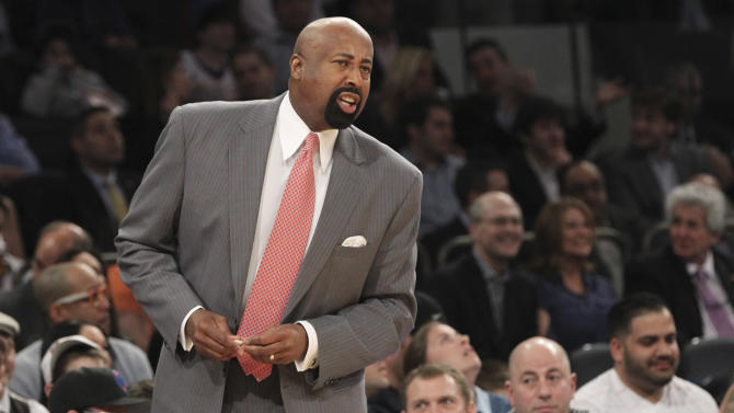New York Knicks head coach Mike Woodson gives his team direction during the first half of an NBA basketball game against the Washington Wizards, Tuesday, April 9, 2013, at Madison Square Garden in New York. The Knicks won 120-99.  (AP Photo/Mary Altaffer)