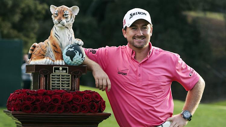 Graeme McDowell poses with the trophy after winning the World Challenge golf tournament at Sherwood Country Club in Thousand Oaks, Calif., Sunday, Dec. 2, 2012. (AP Photo/Bret Hartman)