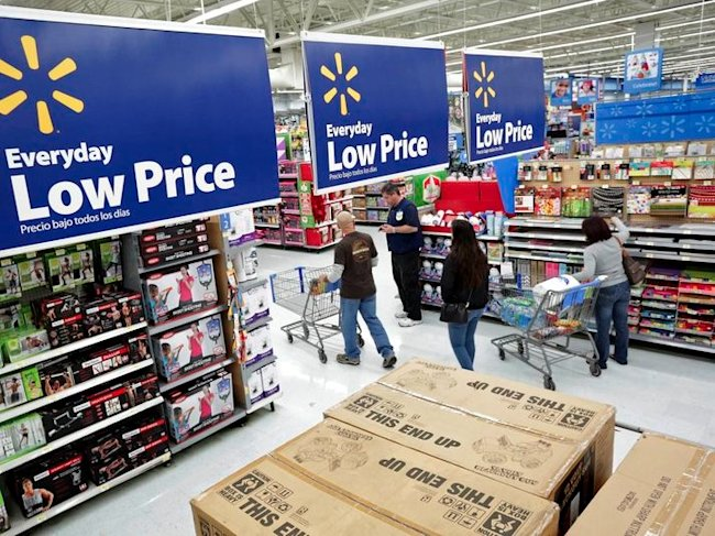 Residents shop at Walmart as the store prepares for Black Friday in Los Angeles, California in a November 24, 2014 file photo. REUTERS/Jonathan Alcorn...