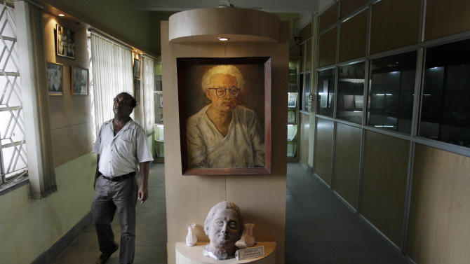 "A portrait of Indian scientist Satyendranath Bose, is displayed at the Bangiya Vigyan Parishad or the Bengal Science Society founded by Bose in Kolkata, India, Tuesday, July 10, 2012. While much of the world was celebrating the international cooperation that led to last week's breakthrough in identifying the existence of the Higgs boson particle, many in India were smarting over what they saw as a slight against one of their greatest scientists. Media covering the story gave lots of credit to British physicist Peter Higgs for theorizing the elusive subatomic ""God particle,"" but little was said about Satyendranath Bose, the Indian after whom the boson is named. (AP Photo/Bikas Das)"