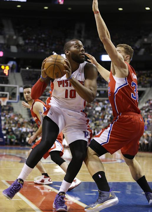Detroit Pistons power forward Greg Monroe (10) is defended by Los Angeles Clippers power forward Blake Griffin (32) during the first half of an NBA basketball game in Auburn Hills, Mich., Monday, Jan.