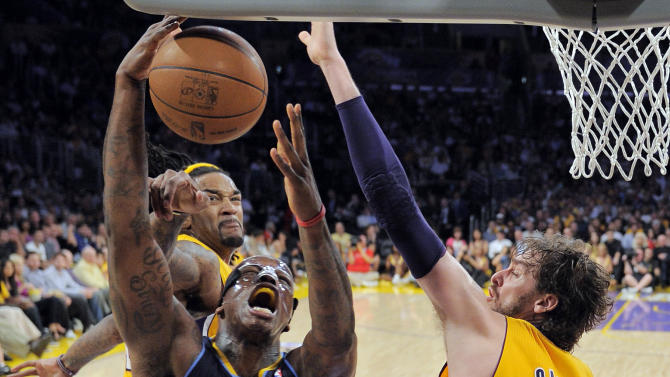 Denver Nuggets forward Al Harrington, center, puts up a shot as Los Angeles Lakers center Jordan Hill, left, and forward Pau Gasol of Spain defend during the first half in Game 5 of an NBA first-round playoff basketball game, Tuesday, May 8, 2012, in Los Angeles. (AP Photo/Mark J. Terrill)