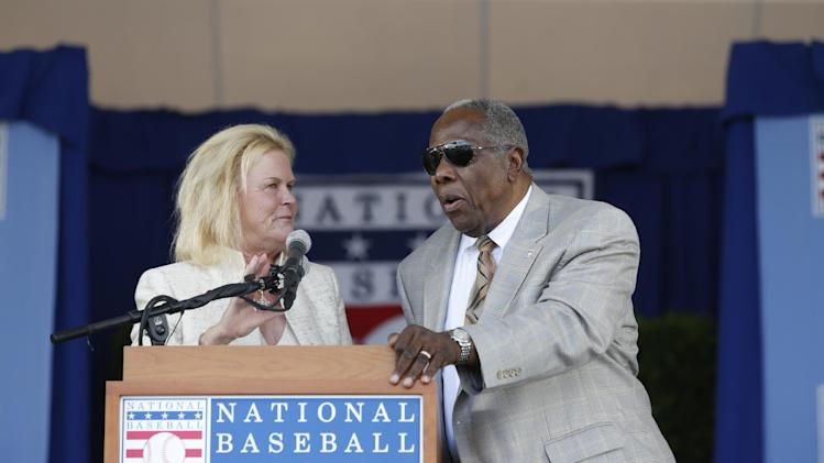National Baseball Hall of Fame Chairman Jane Forbes Clark, left, and Hall member Hank Aaron during an induction ceremony at the Clark Sports Center on Sunday, July 27, 2014, in Cooperstown, N.Y. (AP Photo/Mike Groll)