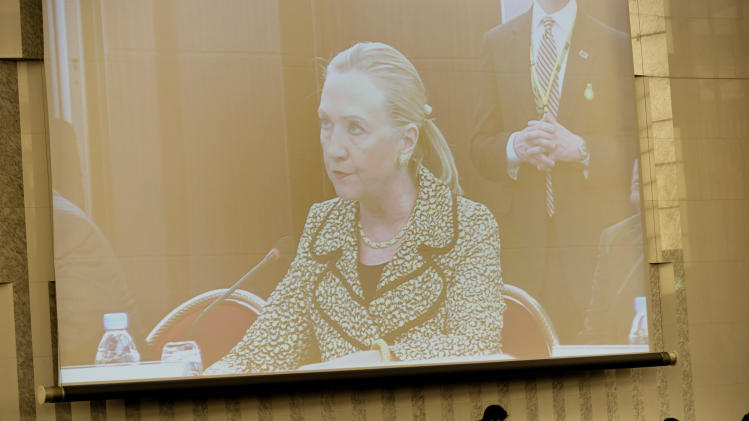 U.S. Secretary of State Hillary Rodham Clinton, seen on a screen, speaks during a plenary session of an international conference on Afghan civilian assistance at a hotel in Tokyo Sunday, July 8, 2012. (AP Photo/Brendan Smialowski, Pool)