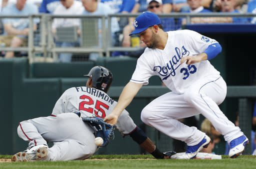 Santana, late rally lift Royals over Twins 3-1