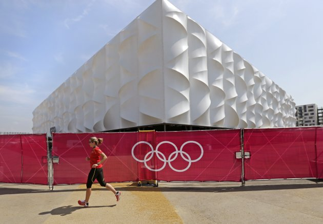 Jasmin Sternkicker, a physical therapist for the Germany Olympic team, runs past the basketball arena as she works out at the 2012 Summer Olympics, Wednesday, July 25, 2012, in London. The opening ceremonies for the 2012 London Olympics will be held Friday, July 27.(AP Photo/Charles Krupa)