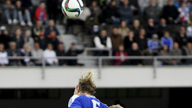HJK Helsinki's Heikkila and Lampi jump for a header during their pre-season friendly soccer match against Liverpool in Helsinki