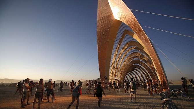 """Light is reflected from the Temple of Promise during the Burning Man 2015 """"Carnival of Mirrors"""" arts and music festival in the Black Rock Desert of Nevada"""