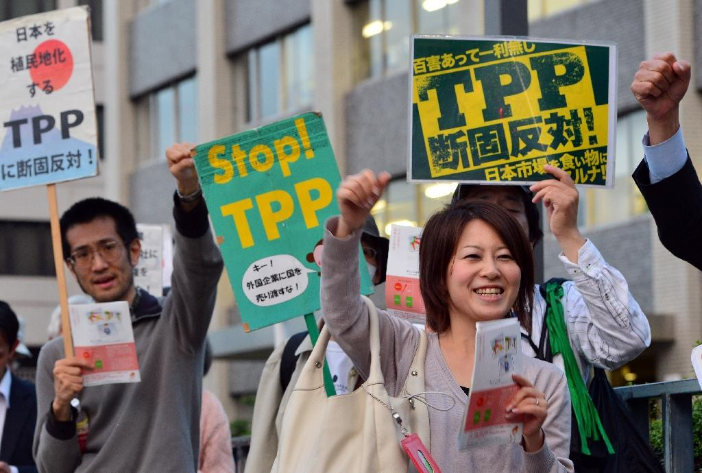Protestors chant against the Trans-Pacific Partnership trade agreement
