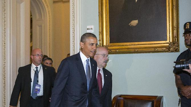 President Barack Obama, accompanied by Sergeant at Arms and Doorkeeper Terrance Gainer, arrives on Capitol Hill in Washington, Tuesday, Sept. 10, 2013, to meet with Senate Democrats and Republicans on Syria, a day after an unexpected Russian proposal for Syria to avert a U.S. military strike by relinquishing control of its chemical weapons. (AP Photo/J. Scott Applewhite)
