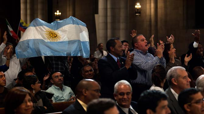 Supporters of Venezuelan president Hugo Chavez cheer during a prayer service for his health at Riverside Church, Wednesday, Sept. 21, 2011, in the Manhattan borough of New York. (AP Photo/John Minchillo)