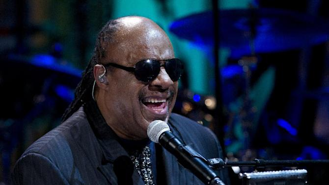 "FILE - In this May 9, 2012 file photo, Stevie Wonder performs during the ""In Performance at the White House"" in the East Room of the White House in Washington. A piano used by Stevie Wonder when he was a student in Michigan has been loaned to the Museum of the American Printing House for the Blind in Louisville, Ky., and will be on display starting next week. The 1922 Steinway grand piano was long used by students at the Michigan School for the Blind, where Wonder, a child prodigy, studied in the mid-1960s. Wonder signed with Motown at the age of 11 and went on to become a singer, songwriter and multi-instrumentalist. It goes on display starting Oct. 11. (AP Photo/Carolyn Kaster, File)"