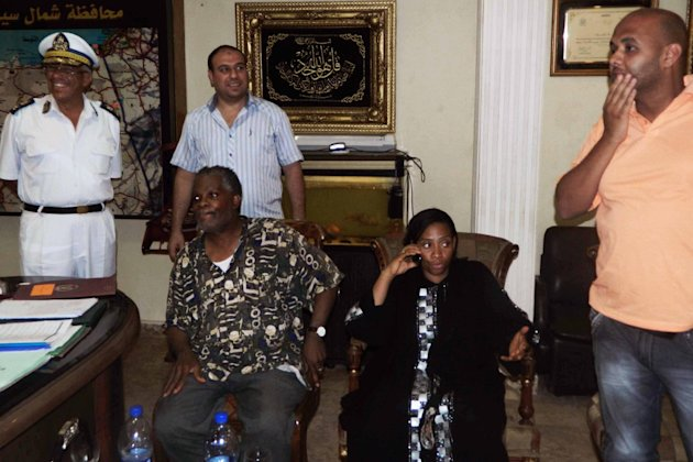 Rev. Michel Louis, 61, left, and 39-year-old Lissa Alphonse, second right, rest after their release at a police station in El Arish, in the northern part of Egypt's Sinai Peninsula, Monday, July 16, 2012. Two American tourists and their Egyptian guide who were abducted by a Bedouin in Egypt's Sinai Peninsula last week were released unharmed on Monday, a security official and the kidnapper told The Associated Press. The kidnapper, Jirmy Abu-Masuh, told AP that he had handed the three over to security officials near the northern Sinai city of el-Arish on Monday after he was promised that authorities were working on his uncle's release. (AP Photo)