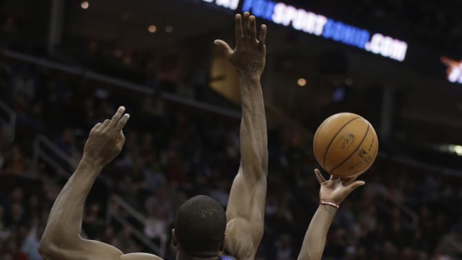 Cleveland Cavaliers' Kyrie Irving (2) shoots over Oklahoma City Thunder's Serge Ibaka (9), from the Republic of Congo, during the second quarter of an NBA basketball game on Saturday, Feb. 2, 2013, in Cleveland. (AP Photo/Tony Dejak)