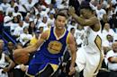 Stephen Curry (L) of the Golden State Warriors drives to the basket during Game Four in the first round of the 2015 NBA Playoffs on April 25, 2015 in New Orleans, Louisiana