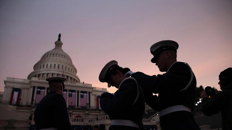 Members of the military prepare at sun rise on the West Front on Capitol Hill in Washington, Monday, Jan. 21, 2013, before the 57th Presidential Inauguration.  (AP Photo/Win McNamee, Pool)