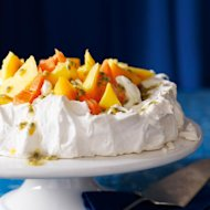 The delicate flavour of coconut transforms this pavlova recipe into a tropical-flavoured pudding. Add a little kirsch to the cream if you want an extra kick