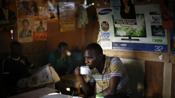"A man drinks coffee in  the Kibera slum of Nairobi, Kenya, Thursday, March 7, 2013. Kenyans on Monday held their first presidential vote since the nation's disputed election in 2007 spawned violence that killed more than 1,000 people. The coalition of Kenya's prime minister Raila Odinga says the vote tallying process now under way to determine the winner of the country's presidential election ""lacks integrity"", should be stopped, and the counting process should be restarted using primary documents from polling stations. (AP Photo/Jerome Delay)"