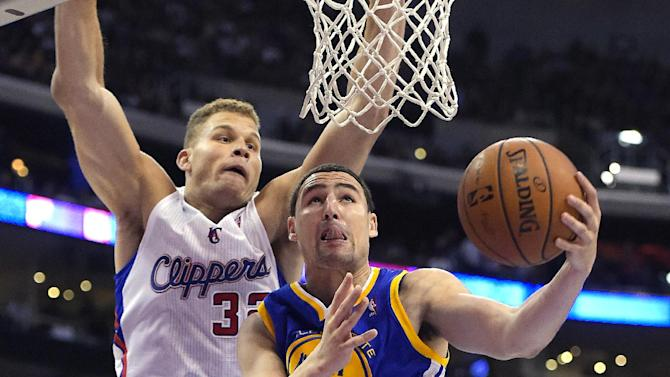 Golden State Warriors guard Klay Thompson, right, puts up a shot as Los Angeles Clippers forward Blake Griffin defends during the second half in Game 5 of an opening-round NBA basketball playoff series, Tuesday, April 29, 2014, in Los Angeles. The Clippers won 113-103. (AP Photo)
