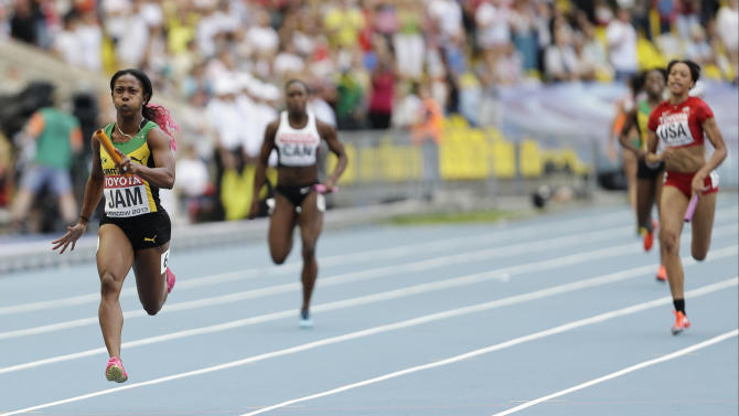 Jamaica's Shelly-Ann Fraser-Pryce competes to win the women's 4x100-meter relay final at the World Athletics Championships in the Luzhniki stadium in Moscow, Russia, Sunday, Aug. 18, 2013. (AP Photo/Anja Niedringhaus)