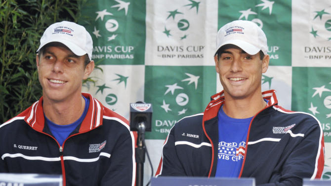 U.S. players Sam Querrey, left, and John Isner listen during a news conference Tuesday, April 2, 2013, for this weekend's Davis Cup tennis match between the United States and Serbia in Boise, Idaho. (AP Photo/Idaho Press-Tribune, Greg Kreller)
