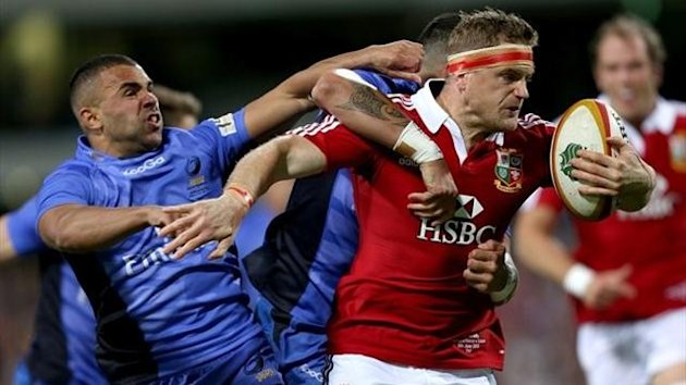 British and Irish Lions' Jamie Heaslip (right) is tackled by Western Force's Chris Tuatara-Morrison (centre) and Corey Brown (left)