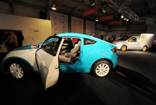 "<p>A sport coupe version of the ""Yo Mobile"" hybrid car, pictured at a 2010 launch in Moscow. Russian billionaire Mikhail Prokhorov's auto division announced Monday it was delaying until late 2014 this year's planned launch of the petrol-guzzling country's first hybrid vehicle.</p>"