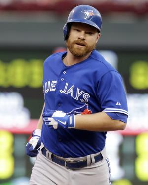 Lind homers twice, drives in 6 as Jays rout Twins