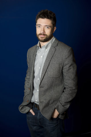 "In this April 16, 2012 photo, actor Topher Grace poses for a portrait in New York. Grace stars in the off Broadway play ""Lonely, I'm Not"" and an independent film called ""The Giant Mechanical Man."" (AP Photo/Charles Sykes)"