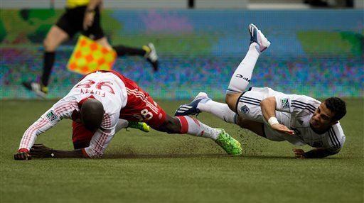 Portland Timbers' Mamadou Danso, left, of Gambia, and Vancouver Whitecaps' Camilo Sanvezzo, of Brazil, collide during the second half of an MLS soccer game in Vancouver, British Columbia on Saturday, 