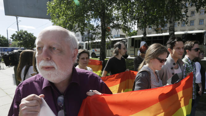 Klaus Bockman of Norway holds a rainbow flag during Ukraine's first gay pride demonstration in Kiev, Ukraine, Saturday, May 25, 2013. About a hundred  gays and lesbians from Ukraine and other countries took part in the gay pride rally, protected by hundreds of riot police. Antipathy toward homosexuals remains strong in Ukraine. (AP Photo/Efrem Lukatsky)