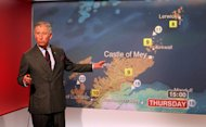 BRitain's Prince Charles reads the weather in the Six O'Clock studio whilst on a tour of the BBC Scotland Headquarters in Glasgow, Scotland where they met staff to celebrate sixty years of BBC Scotland Television Thursday May 10, 2012. (AP Photo/Andrew Milligan/PA Wire) UNITED KINGDOM OUT