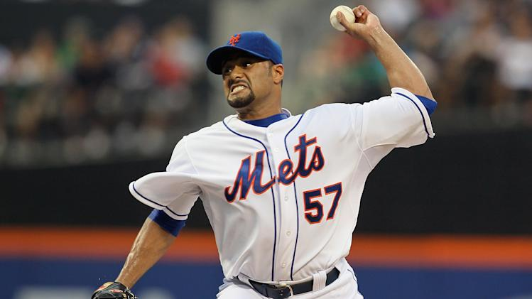 NEW YORK, NY - AUGUST 11: Johan Santana #57 of the New York Mets pitches in the first inning against the Atlanta Braves at Citi Field on August 11, 2012 in the Flushing neighborhood of the Queens borough of New York City.  (Photo by Mike Stobe/Getty Images)