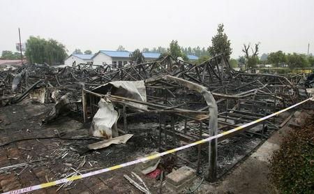 A general view shows the debris after a fire at a rehabilitation centre for elderly in Sanlihe village of Pingdingshan